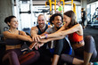 Leinwanddruck Bild - Happy fit friends exercising, working out in gym to stay healthy together