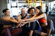Happy Fit Friends Exercising, Working Out In Gym To Stay Healthy Together