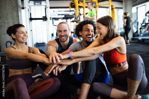 Happy fit friends exercising, working out in gym to stay healthy together Wallpaper Mural