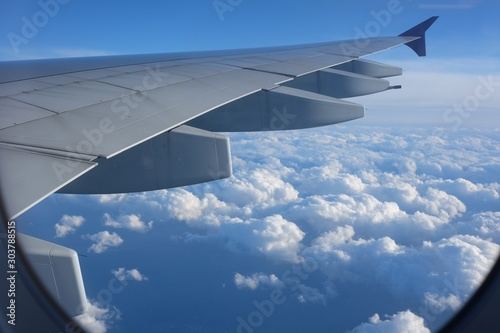 Beautiful sky view from an airplane, dramatic clouds. Fototapete