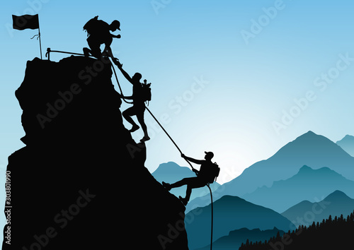 Fotografie, Obraz Silhouette of three men climbing mountain by helping each other on blue mountain