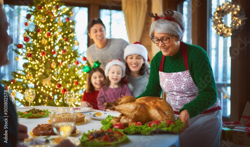 family celebrating Christmas - 303802578