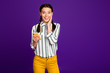 Leinwanddruck Bild - Photo of beautiful lady holding telephone reading instagram post positive good comments and likes wear striped shirt yellow trousers isolated purple color background