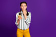 canvas print picture - Photo of beautiful lady holding telephone hiding mouth hand reading negative comments awful situation wear striped shirt yellow trousers isolated purple color background