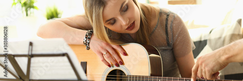 Guitar Playing Lesson Music Education Concept - 303806128