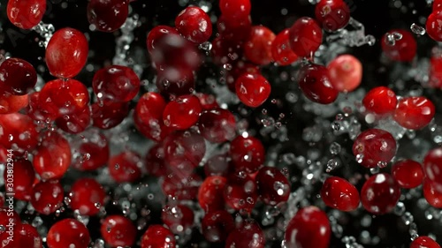 Super Slow Motion Shot of Cranberries and Water Explosion Towards Camera at 1000fps. - 303812944