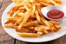 French Fries And Ketchup On Plate