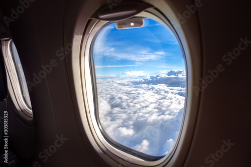 aerial view of nature clear blue sky and cloud from window seat in airplane duri Canvas Print