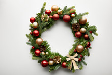 Top View Of Festive Christmas Wreath With Baubles On White Background