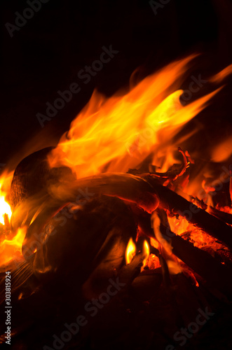 Foto op Aluminium Carnaval Burning wood Bonfire closeup with Red and orange flame on black background