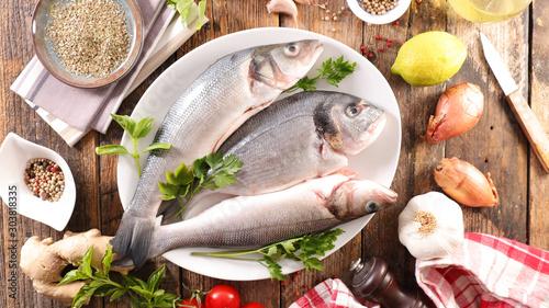Obraz na plátně  raw fish dorado with ingredient for recipe