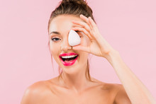 Happy Naked Beautiful Woman With Pink Lips And Open Mouth Holding Makeup Sponge Isolated On Pink