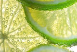 Lemon Slices In Water With Bubbles