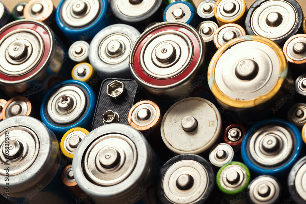 Fototapety, obrazy: Used Alkaline batteries toxic waste recycling and ecology issues concept background