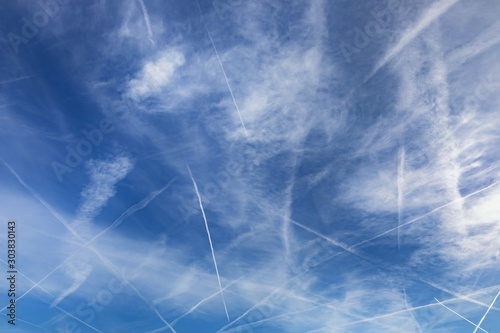 Chemtrails over the blue sky Wallpaper Mural