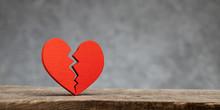 Broken Heart. Crack In The Red Heart, Breaking The Relationship. Grey Background.