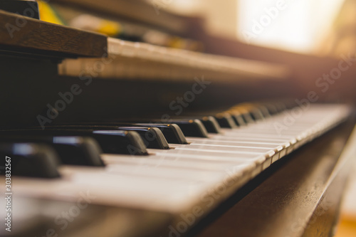 Closeup selective focus vintage piano keys. - 303832567