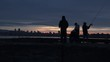 Silhouette of Four Men Fishing on the Water on an Evening at Jericho Beach
