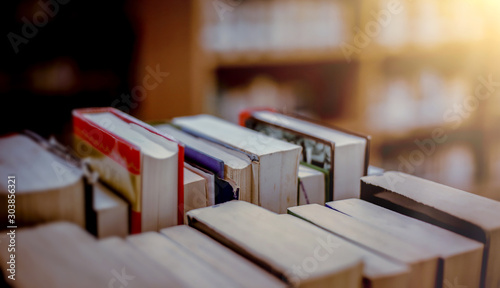 Stack of books in the library and blur bookshelf background Tableau sur Toile