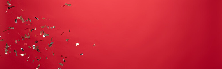 view of golden christmas confetti isolated on red with copy space