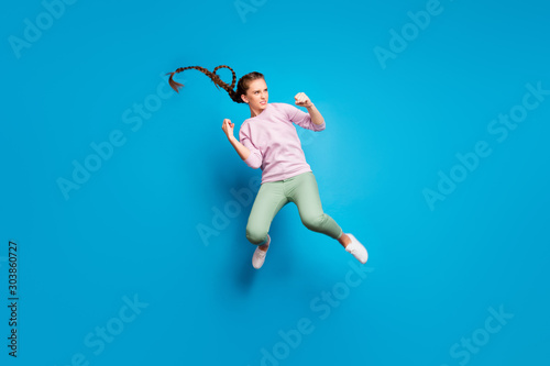 Tableau sur Toile Full size profile side photo of serious youngster girl have fighting battle jump