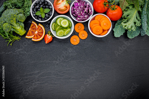 Colourful ingredients for healthy smoothies and juices on dark stone background with copy space Canvas Print