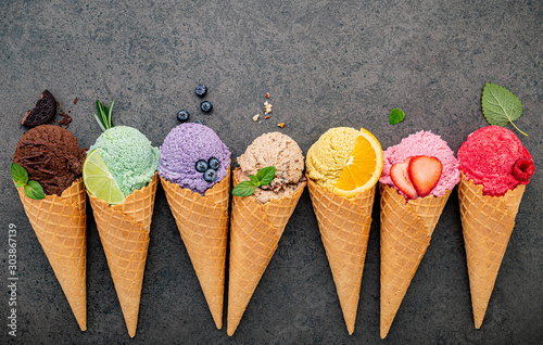 Fototapeta  Flat lay ice cream cones collection on dark stone background