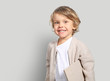 canvas print picture - Very cute little boy with a book in his cardigan