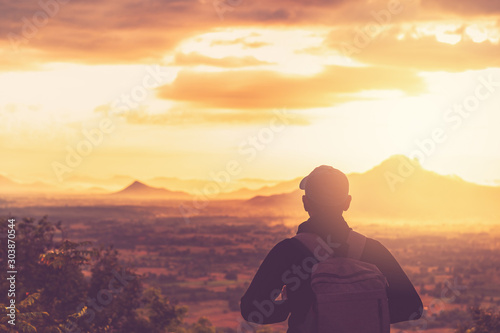 Foto auf Leinwand Landschaft Copy space of backpack man looking view on top of mountain and sunset sky abstract background.