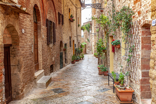 Fototapeta Volterra medieval town Picturesque  houses Alley in Tuscany Italy obraz