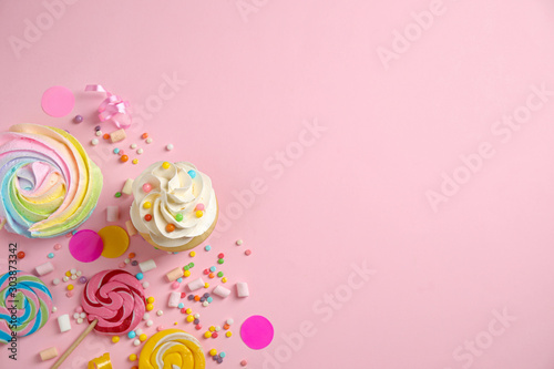 Flat lay composition with cupcake on pink background, space for text Canvas Print