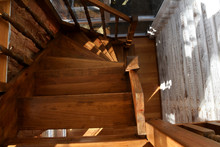 A Wooden Spiral Staircase Is I...
