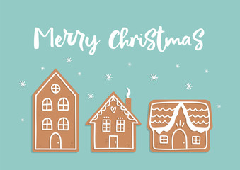 Vector doodle Christmas card with gingerbread houses on blue background