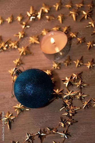 Fototapeta christmas still life with candle and decorations obraz na płótnie