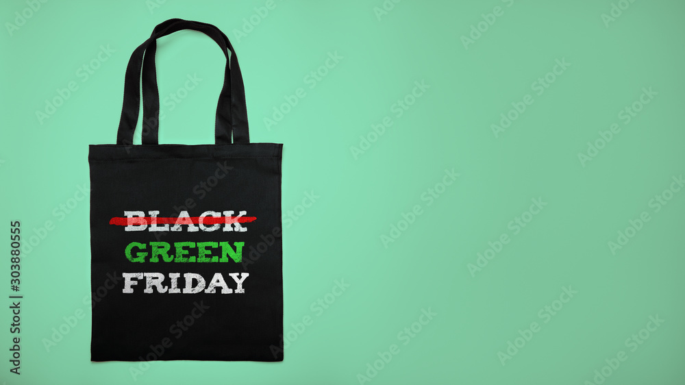 Fototapety, obrazy: Green black friday. Cotton shopping bag with text on green background.