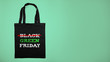 Green black friday. Cotton shopping bag with text on green background.