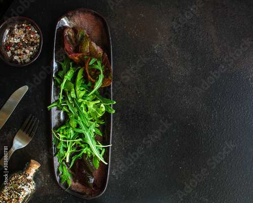 Obraz Healthy salad, leaves mix (mix micro greens, arugula, onion, other ingredients). food background. copy space - fototapety do salonu