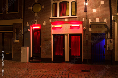 Windows in the red light district of Amsterdam at night Wallpaper Mural