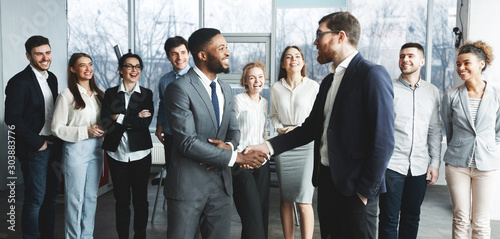 CEO manager congratulating successful worker after meeting