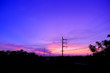 canvas print picture - silhouette of the electricity poles against sky during sunset