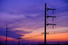 Silhouette Of The Electricity Poles Against Sky During Sunset