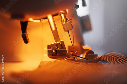 Fotografiet  Close-up of sewing machine and sewing needle in fashion design studio