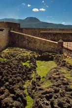 Fort San Felipe With Lava Rock Moat And Isabel De Torres Mountain Puerto Plata Dominican Republic
