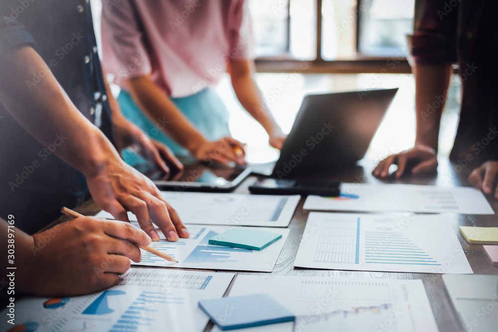 Fototapeta Asian business people meeting new startup project pointing graph discussion and analysis data charts and graphs.Business finances and accounting concept