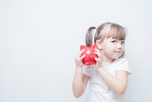 Child Girl Holding A Red Piggy...