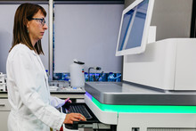Working In A Professional Laboratory Front Of Machines For Analysis In A Laboratory