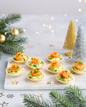 Canapes With Smoked Salmon, Cream Cheese And Avocado On Light Background With Space For Text. Christmas And New Year Holidays Background Concept. Starters Snacks Recipe Ideas.
