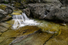 Mountain Flowing Stream With Big Stones