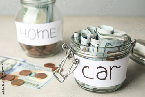 Pinturas sobre lienzo  Glass jar with money and tag CAR on white table