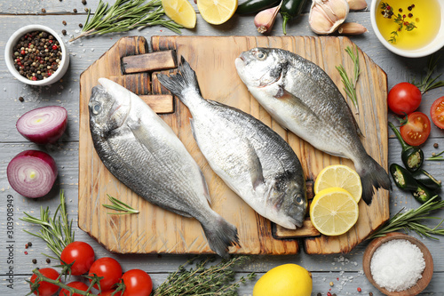 Flat lay composition with raw dorada fish on light grey wooden table Tablou Canvas